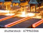 hot steel on conveyor in steel... | Shutterstock . vector #679963366