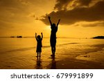 a mother and son playing on the ... | Shutterstock . vector #679991899