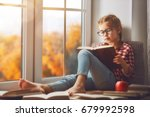 cute child girl sitting by the... | Shutterstock . vector #679992598