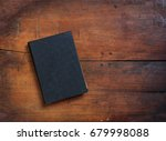 black old closed book on wooden ... | Shutterstock . vector #679998088