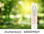 thermometer on a green nature background and temperature measuring, environment concept.