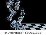 Falling Glass Chess Pieces On ...