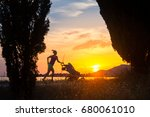 running mother with child in... | Shutterstock . vector #680061010