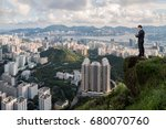 business man on mountain and... | Shutterstock . vector #680070760