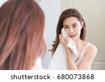 young woman wiping her face... | Shutterstock . vector #680073868