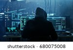 Dangerous Hooded Hacker Breaks...