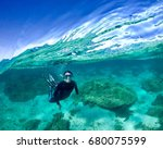 swimmer at ningaloo reef | Shutterstock . vector #680075599