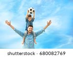 dad and son with soccer ball... | Shutterstock . vector #680082769