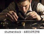 the watchmaker is repairing the ... | Shutterstock . vector #680109298