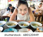 asian woman eating noodle in... | Shutterstock . vector #680120449