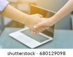 business people shaking hands ... | Shutterstock . vector #680129098