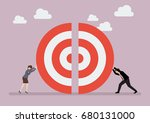 businessman and woman pushing a ... | Shutterstock .eps vector #680131000