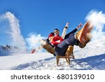 young couple sledding and... | Shutterstock . vector #680139010