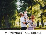 family in a park | Shutterstock . vector #680188084