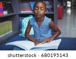 girl reading braille book while ... | Shutterstock . vector #680195143
