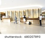 Stock photo abstract blurred hotel lobby luxury interior for background hotel front desk reception counter 680207893
