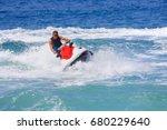 Man On Jet Ski Jump On The Wave