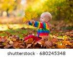 kids play in autumn park.... | Shutterstock . vector #680245348