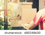 woman accepting a home delivery ... | Shutterstock . vector #680248630