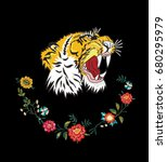 tiger with flowers embroidery | Shutterstock .eps vector #680295979