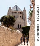Small photo of Jerusalem, Israel, July 14, 2016 : Tourists walk along the passage along the narrow street Ma'ale HaShalom to the Dormition abbey in old tow in Jerusalem