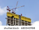 two tower cranes on top of the... | Shutterstock . vector #680343988