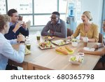 happy business colleagues... | Shutterstock . vector #680365798