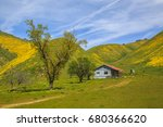 old farmhouse and wildflowers...   Shutterstock . vector #680366620