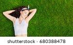 beautiful young woman lies on... | Shutterstock . vector #680388478