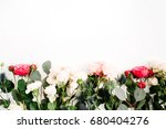Stock photo red and beige rose flowers eringium flower eucalyptus branches and leaves on white background 680404276