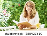 shot of a smiling attractive... | Shutterstock . vector #680421610