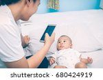 high angle shot of happy mother ... | Shutterstock . vector #680424919