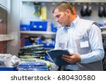 worker pointing products on...   Shutterstock . vector #680430580
