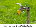 Tap With Water Drops In The...