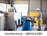 attentive technician operating...   Shutterstock . vector #680461480