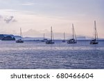 sailboats in harbor at sunset  | Shutterstock . vector #680466604