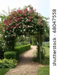 Stock photo rose arch in english country garden 68047558