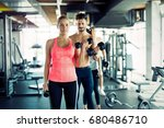 personal trainer helping young... | Shutterstock . vector #680486710