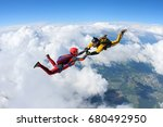 two skydivers are falling... | Shutterstock . vector #680492950