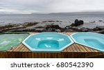 Small photo of The hot natural pools in Drangsnes are right along the shoreline in the middle of the village