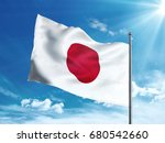 japan flag waving in the blue... | Shutterstock . vector #680542660