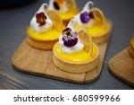 eat delicious biscuit tart with ... | Shutterstock . vector #680599966
