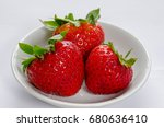 three red ripe strawberries in... | Shutterstock . vector #680636410
