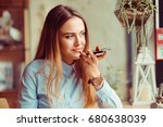 portrait of a girl using the... | Shutterstock . vector #680638039