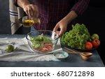 man cooking vegetables salad in ... | Shutterstock . vector #680712898