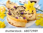 cheesecake with raisins and  almonds poured chocolate for easter - stock photo
