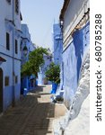 Small photo of Allay of Chefchaouen, Morocco, the striking, variously hued blue-washed old town. Medina of Chefchaouen, Morocco. The Blue City of Morocco. Narrow colorful street in Chefchaouen