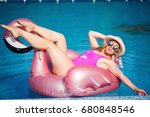 beautiful blonde swimming in... | Shutterstock . vector #680848546