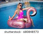 beautiful blonde swimming in... | Shutterstock . vector #680848573