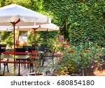 summer street cafe interior in... | Shutterstock . vector #680854180